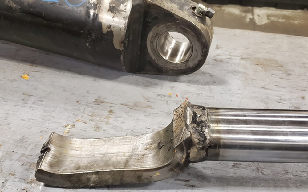 Hydraulic cylinder failure mount connection damage